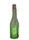 Bottiglia di vetro verde di vino con una candela isolata su backg bianco Immagini Stock