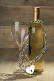 Bottiglia di vino bianco e di un vetro Immagine Stock Libera da Diritti