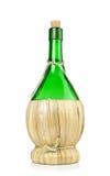 Bottiglia di vino italiana di fiasco Fotografia Stock