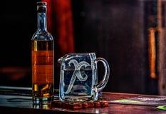Bottiglia di whiskey e brocca di acqua Fotografia Stock