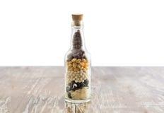 Bottiglia e grani Fotografie Stock Libere da Diritti
