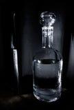 Bottiglia e lama Fotografie Stock Libere da Diritti