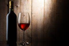 Bottiglia e lucentezza di vino Immagine Stock