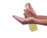 Bottiglia e mano della pompa Fotografia Stock