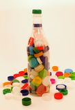Bottiglia e tazze di plastica Immagine Stock Libera da Diritti