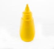 Bottiglia gialla della senape Fotografia Stock