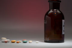Bottiglia medica di vetro con lo spazio della copia Immagine Stock