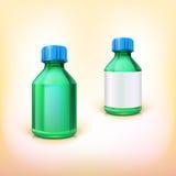 Bottiglia medica verde con il coperchio blu Fotografie Stock Libere da Diritti
