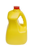 Bottiglia per il latte con il percorso di residuo della potatura meccanica Fotografia Stock