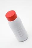 Bottiglia per il latte di plastica con una protezione rossa Fotografia Stock Libera da Diritti