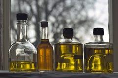 Bottiglia quattro di olio d'oliva immagini stock libere da diritti