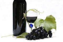 Bottiglia, vetro ed uva di vino Fotografie Stock