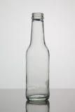 Bottiglia vuota su fondo bianco Immagine Stock Libera da Diritti