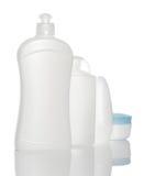 Bottiglie bianche dei prodotti di bellezza e di salute Fotografia Stock