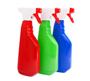 Bottiglie dei prodotti di pulizia isolate su bianco Fotografia Stock