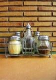 Bottiglie del condimento, ristorante italiano Fotografie Stock Libere da Diritti