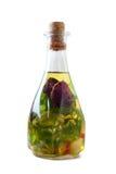 Bottiglie dell'olio di oliva aromatico Fotografia Stock