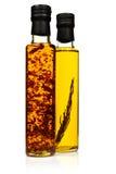 Bottiglie dell'olio di oliva aromatico. Fotografia Stock Libera da Diritti