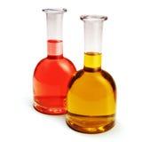 Bottiglie dell'olio e dell'all'aceto di oliva Fotografia Stock Libera da Diritti
