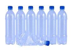 Bottiglie di acqua beventi della plastica Immagini Stock