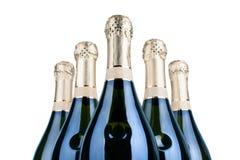 Bottiglie di champagne o di vino spumante su fondo bianco isolato vicino su, elemento di progettazione fotografia stock libera da diritti