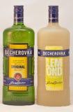 Bottiglie di Karlovarska Becherovka contro bianco Fotografia Stock