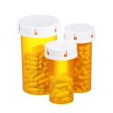 Bottiglie di pillola isolate su fondo bianco Fotografia Stock