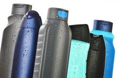 Bottiglie di plastica dei prodotti di cura e di bellezza del corpo Fotografia Stock