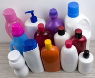 Bottiglie di plastica su bianco Immagine Stock