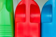 Bottiglie di plastica variopinte della lavanderia Immagine Stock