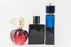Bottiglie di profumo sopra bianco Fotografia Stock Libera da Diritti