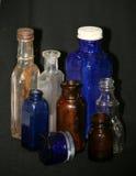Bottiglie di vetro d'annata Immagine Stock