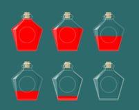 Bottiglie di vetro Liquido di varia pienezza Fotografie Stock Libere da Diritti