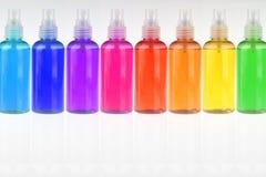 Bottiglie differenti di colore fotografia stock libera da diritti