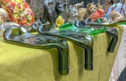 Bottiglie fuse verdi piane come supporti di candela Fotografia Stock Libera da Diritti