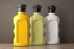 Bottiglie multicolori del cosmetico dell'hotel rappresentazione 3d Immagini Stock Libere da Diritti