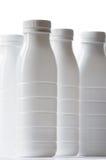 Bottiglie per il latte bianche Immagine Stock