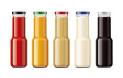 Bottiglie per le salse Immagine Stock