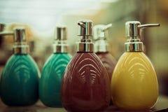Bottiglie per sapone nel deposito Fotografie Stock Libere da Diritti
