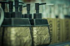 Bottiglie per sapone nel deposito Fotografia Stock