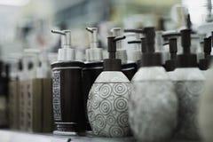 Bottiglie per sapone nel deposito Fotografia Stock Libera da Diritti