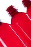 Bottiglie rosse vuote Fotografia Stock