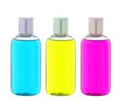 Bottiglie variopinte del sapone liquido isolate su bianco Fotografie Stock