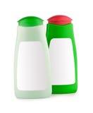 Bottiglie verdi con il contrassegno in bianco Fotografia Stock
