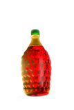 In a bottle. The illuminated wine in a bottle plays bright paints Royalty Free Stock Photos