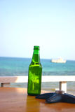 The bottle 2. The bottle on the table next to the beach royalty free stock photo
