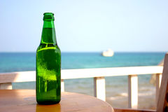 The bottle 3. The bottle on the table next to the beach royalty free stock photos