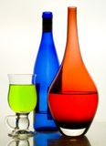 Bottle. Composition from glasses with multi-coloured drinks Royalty Free Stock Photography