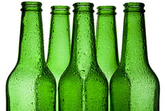 Bottle. Green bottels cover drops water Royalty Free Stock Photography
