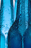 Bottle. There are blue bottles with water drops Stock Photo